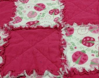 Pink flanneletteladybug crib size rag quilt