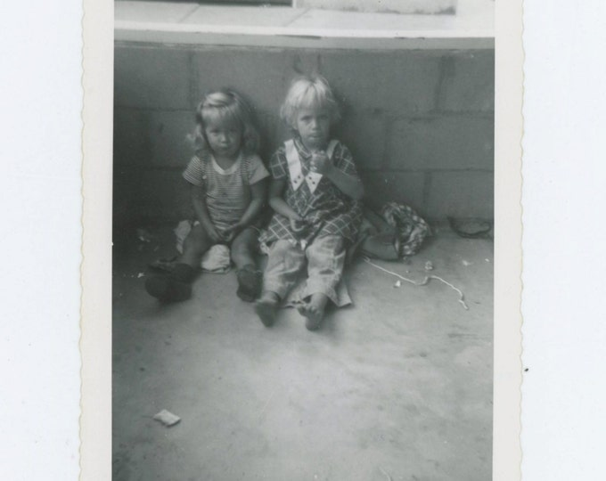 Vintage Snapshot Photo: Two Small Girls Leaning Against a Wall, c1950s (68495)