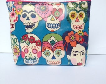 cosmetic bag, makeup bag, small wet bag, zipper pouch. Colourful sugar skulls. Frido  Kahlo laminate and Mexican oilcloth .Water resistant.