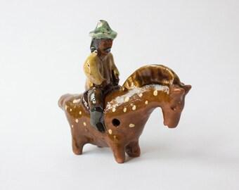 Ceramic whistle horseman. Handmade ceramics. Miniatiure, figurine.