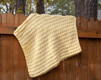 Lofty knitted baby blanket