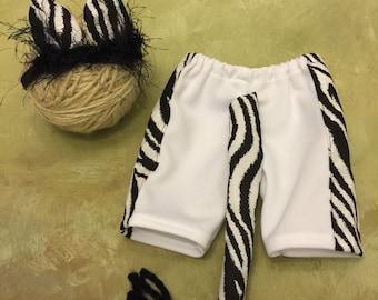 Newborn zebra pants with matching headband rears