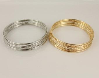 Silver  or Gold set pack of 7 metal thin skinny bangle bracelet shiny textured stack stackable bracelets