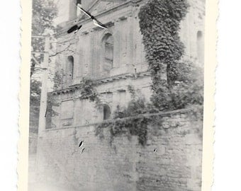 Old stone building with climbing ivy in Germany. Writing on the back #146