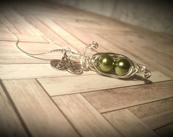 Custom hand stamped and wire wrapped Peapod Necklace