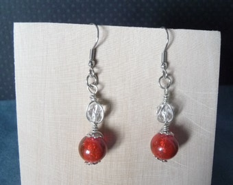 Earrings with red glass beads and silver wire