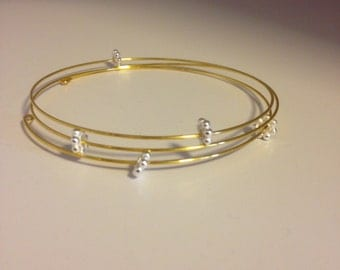 Gold stacker bracelet with silver flowers