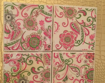 set of four pink and green floral coasters