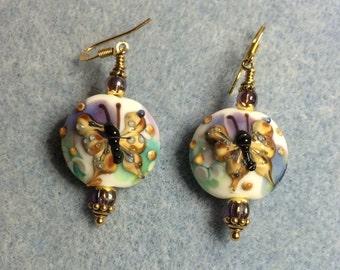 Purple and tan lampwork butterfly bead earrings adorned with purple Czech glass beads.