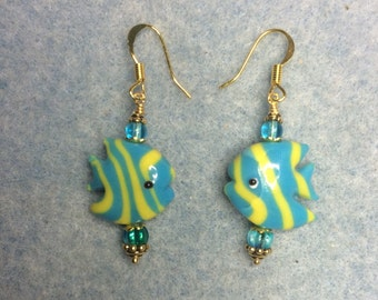 Turquoise and yellow striped lampwork angelfish bead dangle earrings adorned with turquoise Czech glass beads.