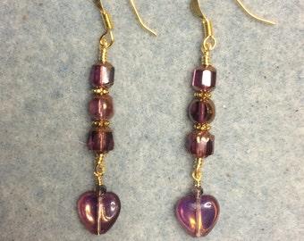 Violet Czech glass heart bead dangle earrings adorned with violet Czech glass beads.