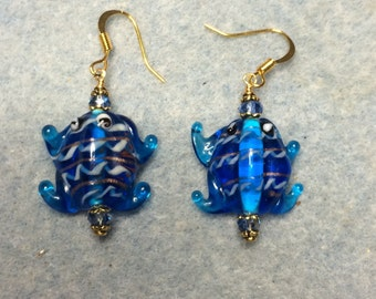 Turquoise blue lampwork frog bead earrings adorned with turquoise Chinese crystal beads.