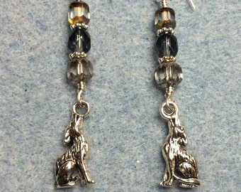 Silver howling wolf charm dangle earrings adorned with grey Czech glass beads.