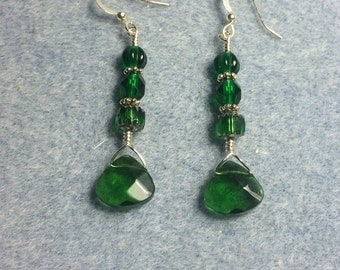 Emerald green briolette dangle earrings adorned with emerald green Czech glass beads.