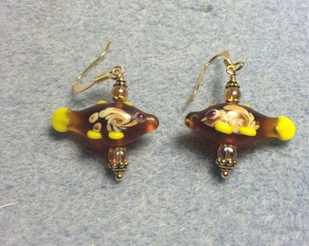 Amber lampwork fish bead dangle earrings adorned with amber Czech glass beads.