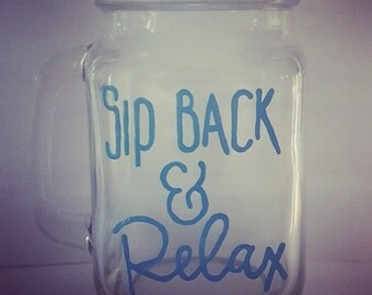"hand painted ""sip back and relax"" drinking jar."