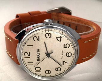 """LARGE Vintage men's watch """"Raketa """"(eng.Rocket).Soviet mechanical watch with rare dial.Comes with new quality leather band!"""