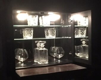 Wall mounted drinks cabinet.