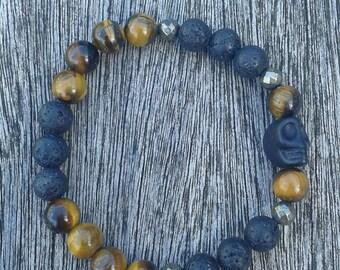 "Elastic mens bracelet of Tiger eye and black lava stones ""Black skull"""