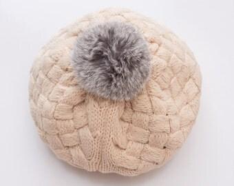 Knitted beanie with faux fur pom pom