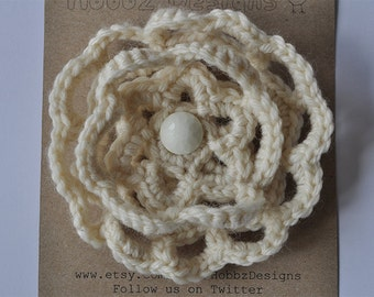 Crocheted cream flower corsage