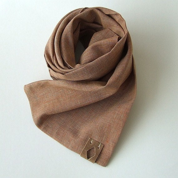 Today men's scarves can be worn in a variety of ways, from an edgy knot to a simple throw over the neck and shoulders. In India, grooms wear a scarf over their sherwani, a .