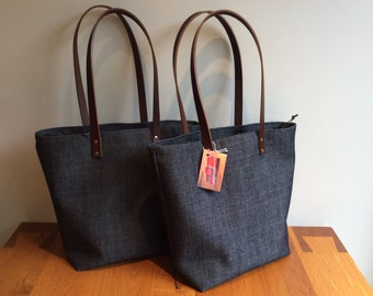 Trendy and stylish denim tote bag, shoulder bag, laptop bag with leather handles and a zippered closure