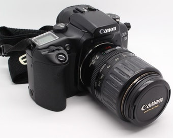 Canon EOS 33 / Elan 7 SLR 35mm Film Camera with 35-135mm EF zoom lens + case - Very good condition