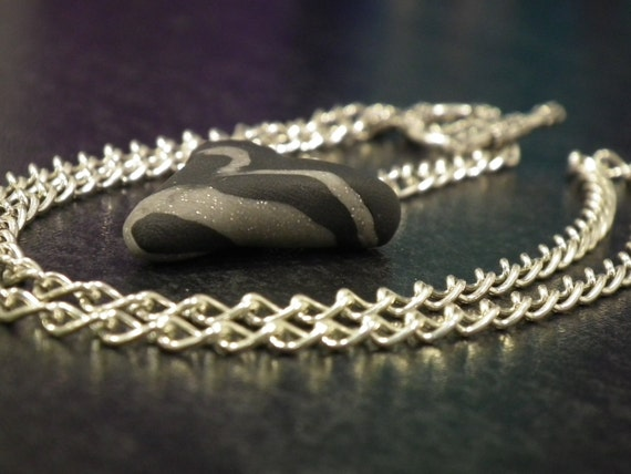 Unique black and grey metallic clay heart with long chain