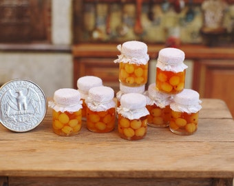 Compote. Miniature apricot compote. Compote in the dollhouse. Miniature in a dollhouse. Miniature.  Apricot. Miniature canned. a scale 1/12