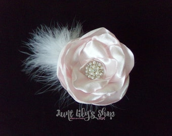 Hair accessory, soft pink satin flower, white feathers.