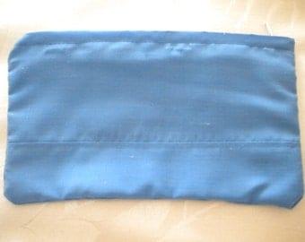 Small zippered bag.  Mid blue cotton. 17cm x 10cm. Washable.