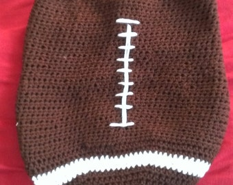 Football baby cocoon and hat