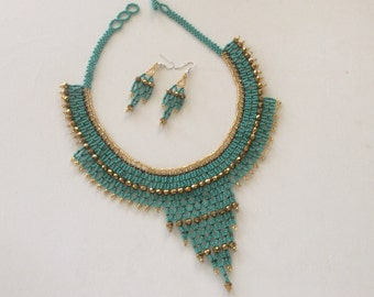Beautiful, hand beaded and crystal necklace with matching earrings.Turquoise and bronze hand strung necklace. Hand beaded in Guatemala.