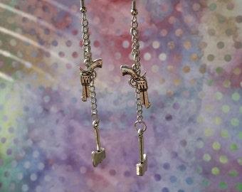 handgun and hatchet earrings