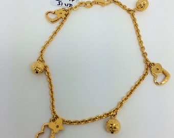 18K Yellow Gold Mixed Charms Bracelet