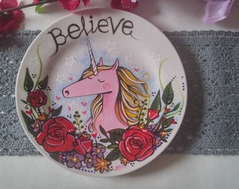 Hand painted plate with unicorn-flowers-word BELIEVE painted across the top. Quirky and magical piece.