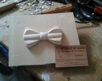Entirely hand-carved wooden bow tie.