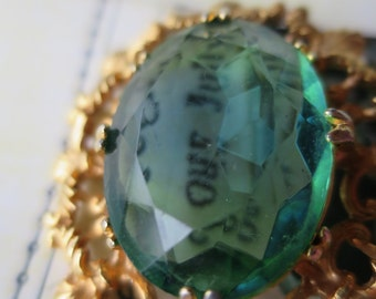 Pretty Faceted Glass Faux Emerald 1950 Brooch