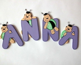 Wooden alphabet letters with a small beetle