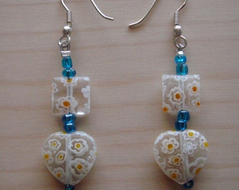 White flower heart earrings with blue accents