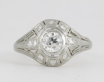 Vintage diamond platinum engagement ring. estimated .55 carat old European. Circa 1930.