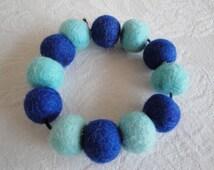 blue felt elasticated bracelet, aqua blue bracelet, felt bead bangle, elasticated felt cuff, felted wool bracelet, textile jewelry for women