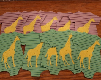Ten adorable paper onsies..string on a garland for baby shower