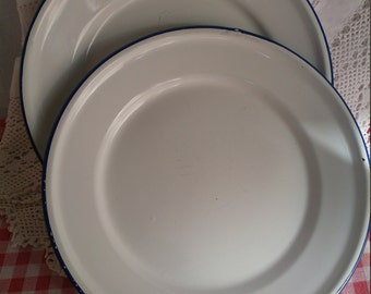 Pair of smaller white enamel plates with blue border. Diameter 8 3/4 inches.