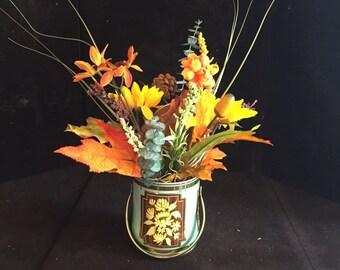 Beautiful flower arrangement in a vintage tin