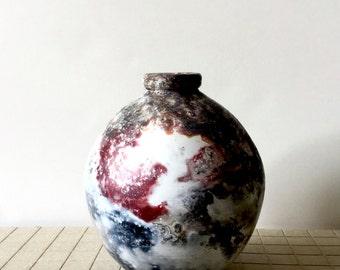 Handmade pit fired ceramic vase