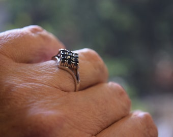 silver ring with 9 saffire stones