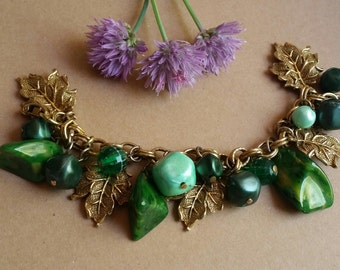 Vintage Bakelite charm bracelet with gold tone metal leaves and plastic/lucite beads. 1950's, Pin Up, Viva, Rockabilly