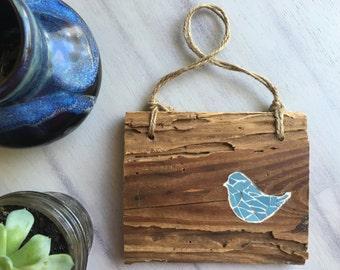 Blue bird on reclaimed barn wood